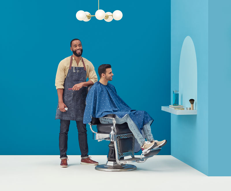 Barber giving a customer a haircut